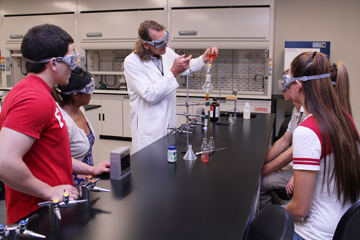 Organic chemistry faculty with students in the lab