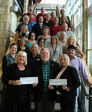 A check for proceeds from the RLS Productions' Concert in the Gardens series is presented to the WVC Foundation